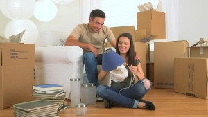 couple packing with boxes